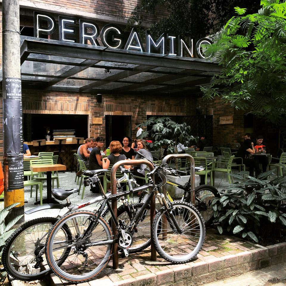 Pergamino Cafe with outdoor seating and bikes in Medellin